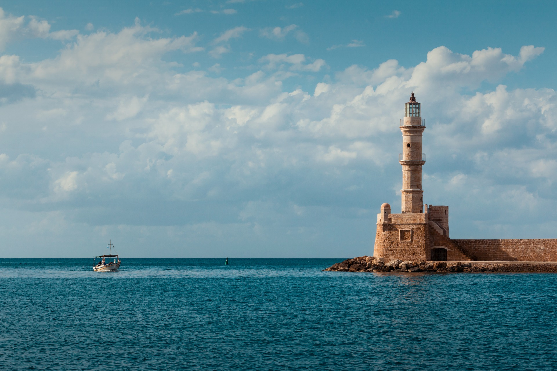 Lighthouse and the fishing boat